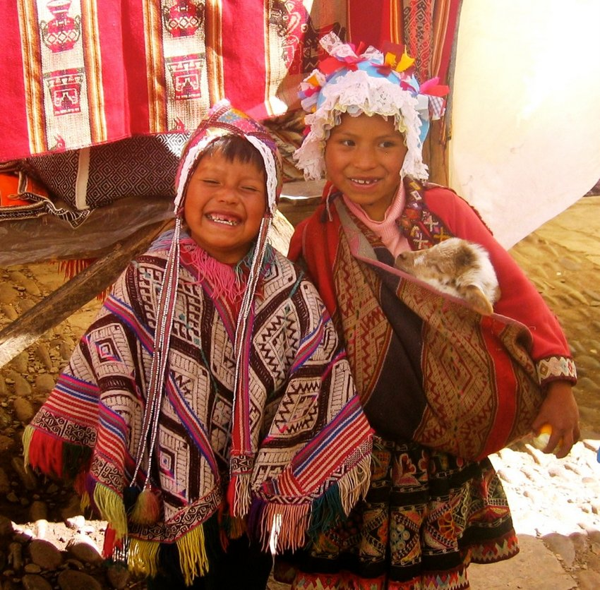 Today's smiling faces travel photo is of two cute children wearing traditional attire with big grins located in Pisac, a small town in Peru's sacred valley.